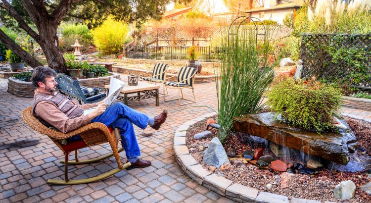 man relaxing outdoors on patio