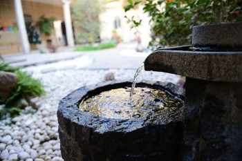 outdoor water fountain on sheltered patio